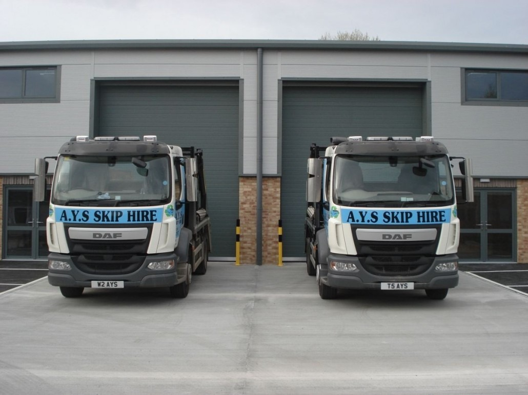 2 skip delivery vehicles