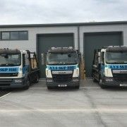 Three AYS Skip Hire vans parked up on site